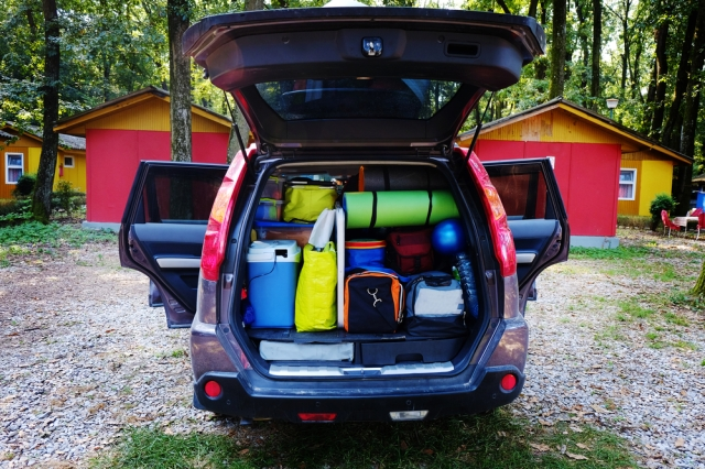 SUV packed with vacation supplies in an organized fashion